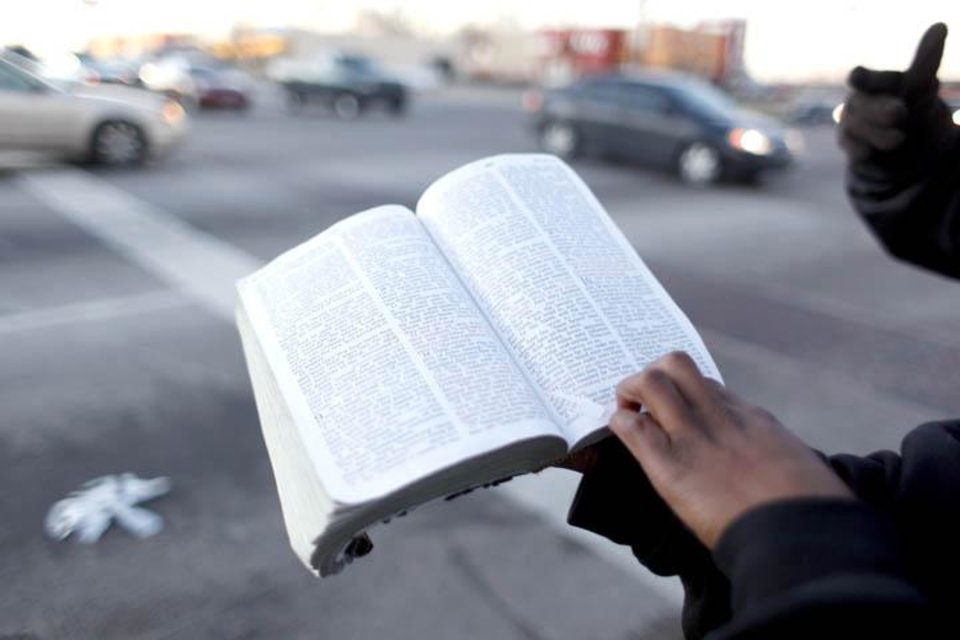 Photo -  Members of Israelite Church of God in Christ preach on the corner of Martin Luther King Avenue and 23rd Street in Oklahoma City, Monday, Jan. 11, 20010. Photo by Sarah Phipps, The Oklahoman
