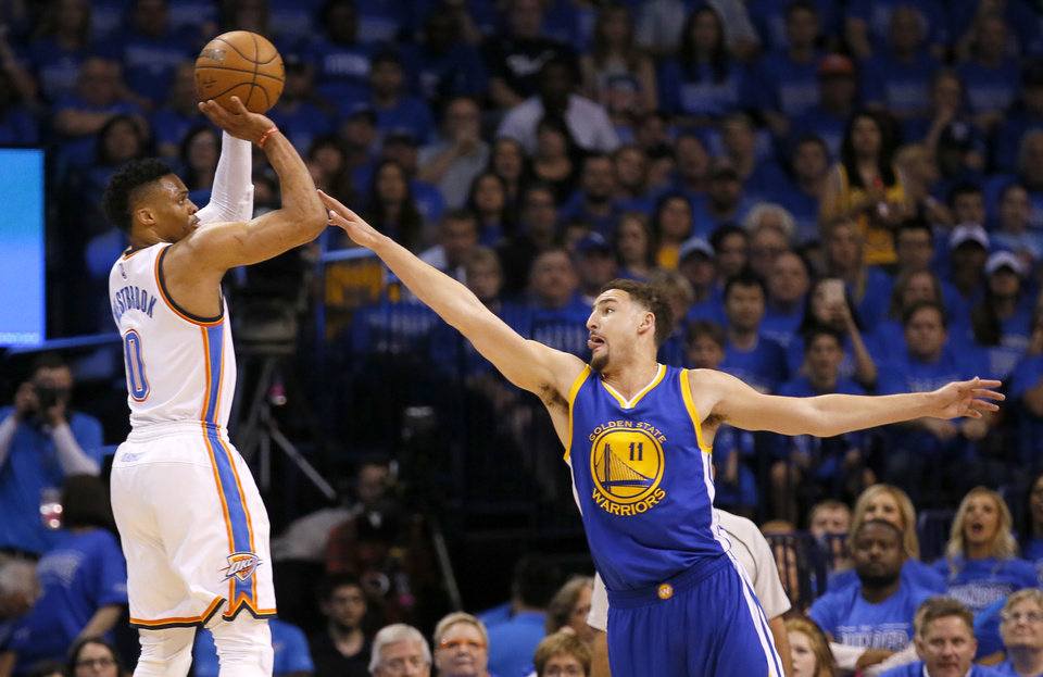Photo - Oklahoma City's Russell Westbrook (0) shoots over Golden State's Klay Thompson (11) during Game 6 of the Western Conference finals in the NBA playoffs between the Oklahoma City Thunder and the Golden State Warriors at Chesapeake Energy Arena in Oklahoma City, Saturday, May 28, 2016. Photo by Sarah Phipps, The Oklahoman