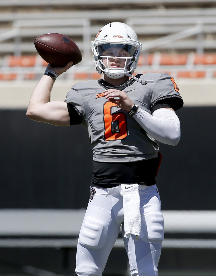 Photo - Oklahoma State's Dru Brown (6) looks to throw during drills during the Oklahoma State Cowboys spring practice at Boone Pickens Stadium in Stillwater, Okla., Saturday, April 20, 2019.  Photo by Sarah Phipps, The Oklahoman