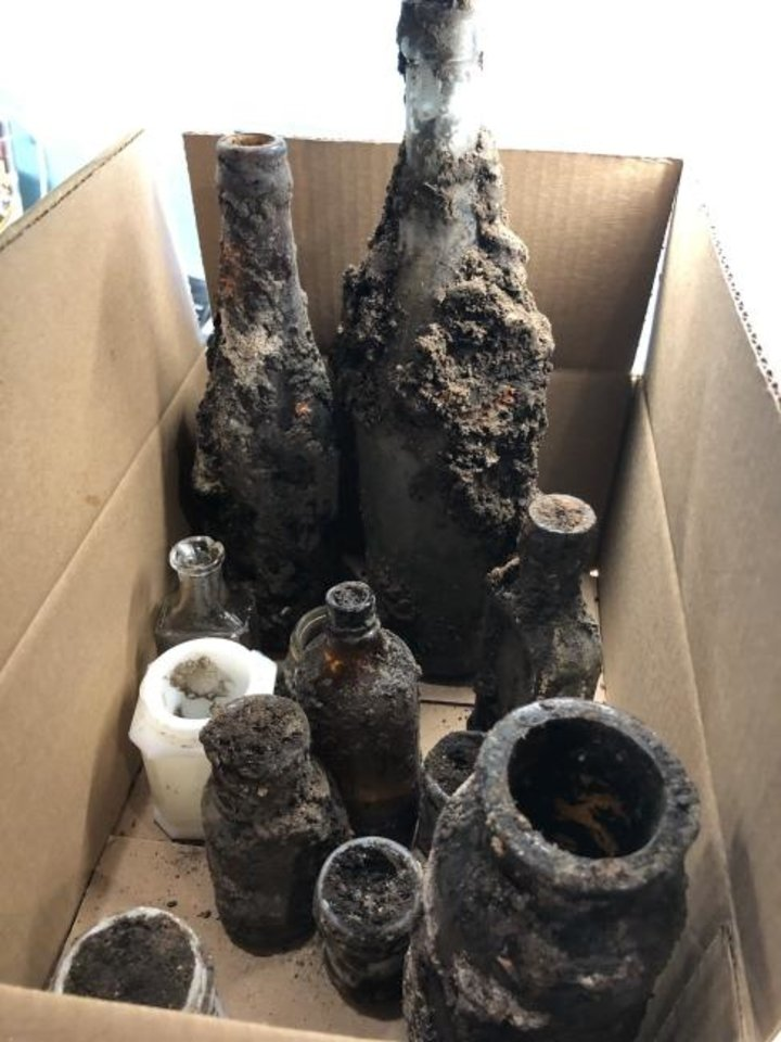 Photo -  Several decades-old bottles were retrieved from the southeast corner of Oklahoma and Sheridan avenues where debris from a 1955 explosion was discovered. [PROVIDED BY CHAD HUNTINGTON]