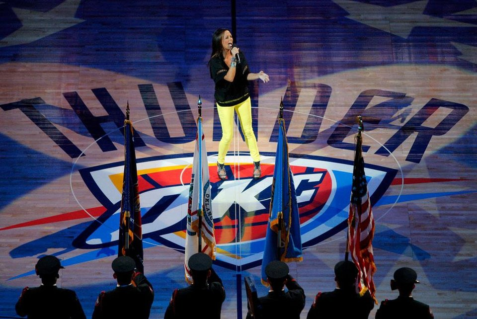 Photo -  Sara Evans sings the national anthem before Game 2 of the NBA Finals between the Oklahoma City Thunder and the Miami Heat at Chesapeake Energy Arena in Oklahoma City, Thursday, June 14, 2012. Photo by Bryan Terry, The Oklahoman