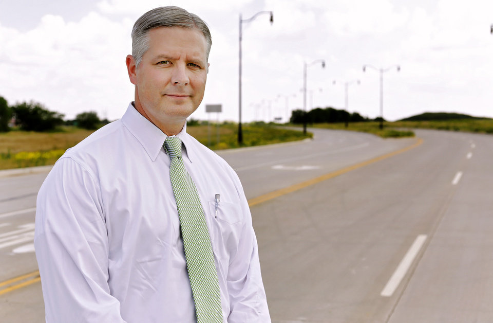 Photo - City of Oklahoma City's director of public works and city engineer Eric Wenger P.E. poses for a photo on the new stretch of south Portland Ave. near Will Rogers World Airport at SW 74th and Portland Ave. in Oklahoma City, Okla. on Thursday, June 16, 2016.  Photo by Chris Landsberger, The Oklahoman