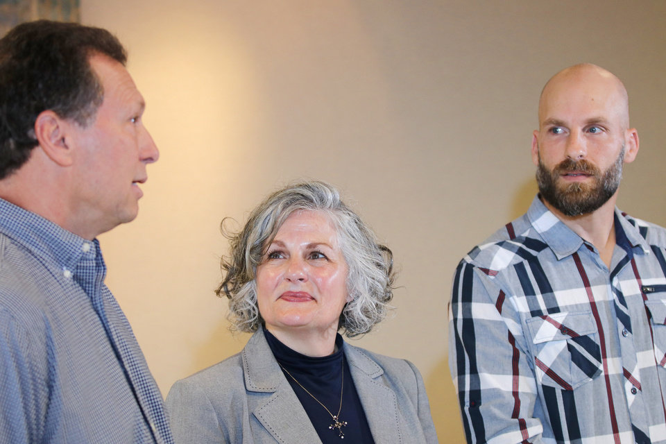 Photo - Scott, Vicki and Michael Behenna at a family press conference for the Presidential Pardon Michael Behenna received Monday, in downtown Oklahoma City, Wednesday, May 8, 2019.  Photo by Doug Hoke.