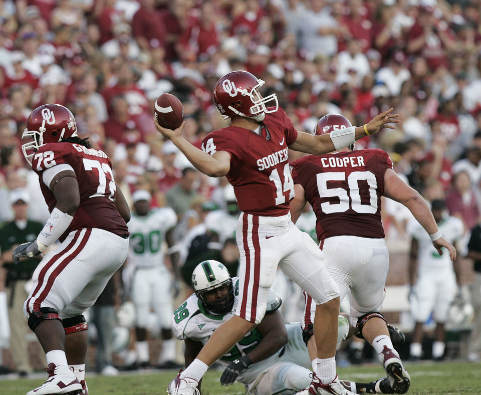 Photo - Oklahoma quarterback Sam Bradford (14) throws for 350 yards in the first half during the University of Oklahoma Sooners (OU) college football game against the University of North Texas Mean Green (UNT) at the Gaylord Family - Oklahoma Memorial Stadium, on Saturday, Sept. 1, 2007, in Norman, Okla.
