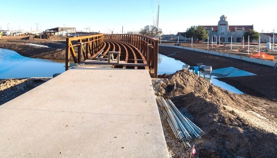 Photo -  The bridge over Scissortail Park lake can be seen in this recent photo. Provided.