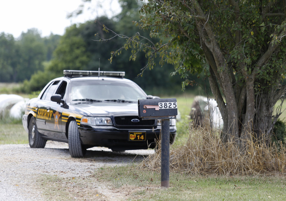 Photo -  A Perry County, Ohio, sheriff's deputy is seen outside of property belonging to Ohio house speaker Larry Householder in rural Glenford, Ohio, Tuesday, July 21, 2020. Householder was taken into custody by federal authorities at the property Tuesday morning as part of a $60 million bribery investigation. (AP Photo/Paul Vernon)