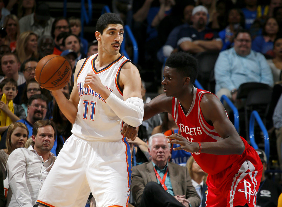 Photo - Oklahoma City's Enes Kanter (11) tries to get past Houston's Clint Capela (15) during an NBA basketball game between the Oklahoma City Thunder and the Houston Rockets at Chesapeake Energy Arena in Oklahoma City, Friday, Jan. 29, 2016. Oklahoma City won 116-108. Photo by Bryan Terry, The Oklahoman