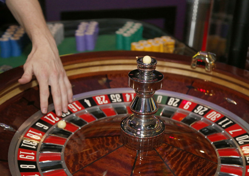 Photo -  Roulette wheel and ball during the first day of Okahoma casinos being able to use ball and dice in Tulsa, OK, Aug. 20, 2018. [STEPHEN PINGRY/Tulsa World]