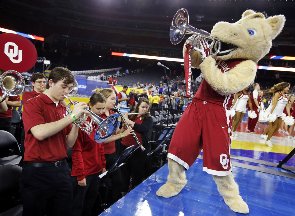 Photo - Oklahoma mascot Boomer pretends to play with the OU band during practice on Final Four Friday before the national semifinal between the Oklahoma Sooners and the Villanova Wildcats in the NCAA Men's Basketball Championship at NRG Stadium in Houston, Friday, April 1, 2016. OU will play Villanova in the Final Four on Saturday. Photo by Nate Billings, The Oklahoman