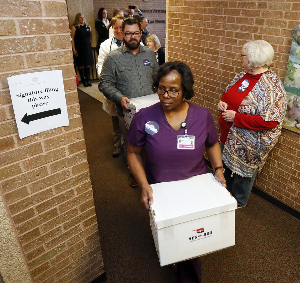 Photo - Supporters of state question 802, Medicaid expansion, deliver petitions to put the question on the ballot to the Oklahoma Secretary of State's office in Oklahoma City, Thursday, Oct. 24, 2019. [Nate Billings/The Oklahoman]