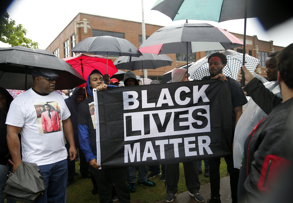 Photo - People march to the Edmond Police Department during a Black Lives Matter protest rally honoring the Life of Isaiah Lewis in Edmond, Okla.,  Friday, May 3, 2019. [Sarah Phipps/The Oklahoman]