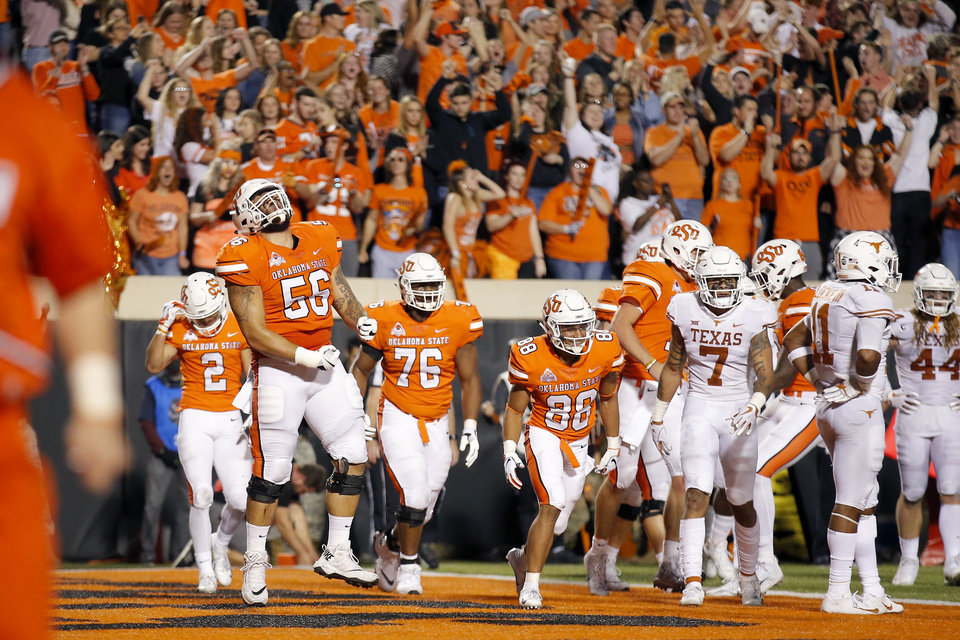 Photo - Oklahoma State's Larry Williams (56) celebrates with teammates after an OSU touchdown in the fourth quarter of a college football game between Oklahoma State (OSU) and University of Texas a at Boone Pickens Stadium in Stillwater, Okla., Saturday, Oct. 27, 2018. Photo by Sarah Phipps, The Oklahoman