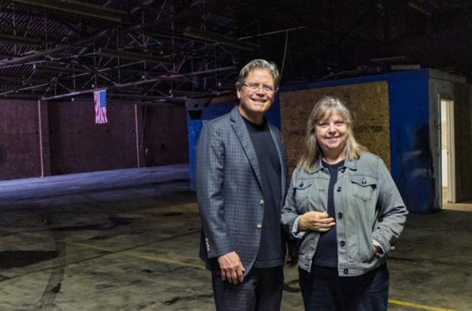 Photo -  Carpenter Square Theatre board chairman Rick Allen Lippert and creative director Rhonda Clark pose for a photo at the theater's future home at 1009 W Reno.  [Chris Landsberger/The Oklahoman]