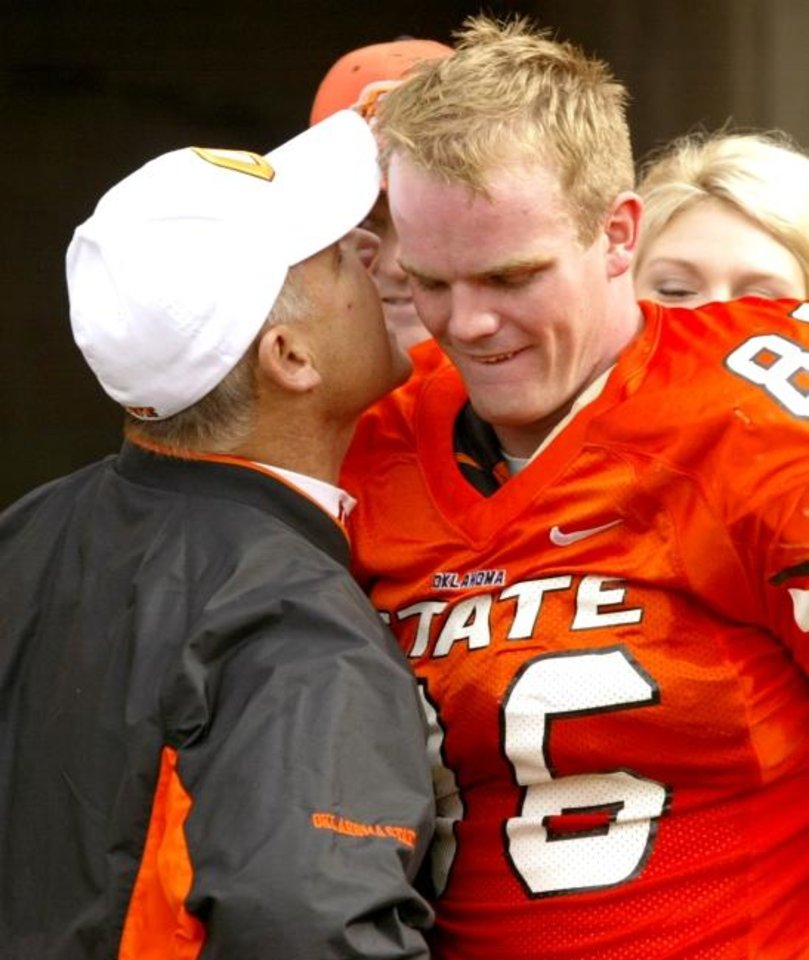 Photo -  Oklahoma State coach Les Miles talks to Billy Bajema during senior day ceremomies in 2004. [Doug Hoke/The Oklahoman Archives]