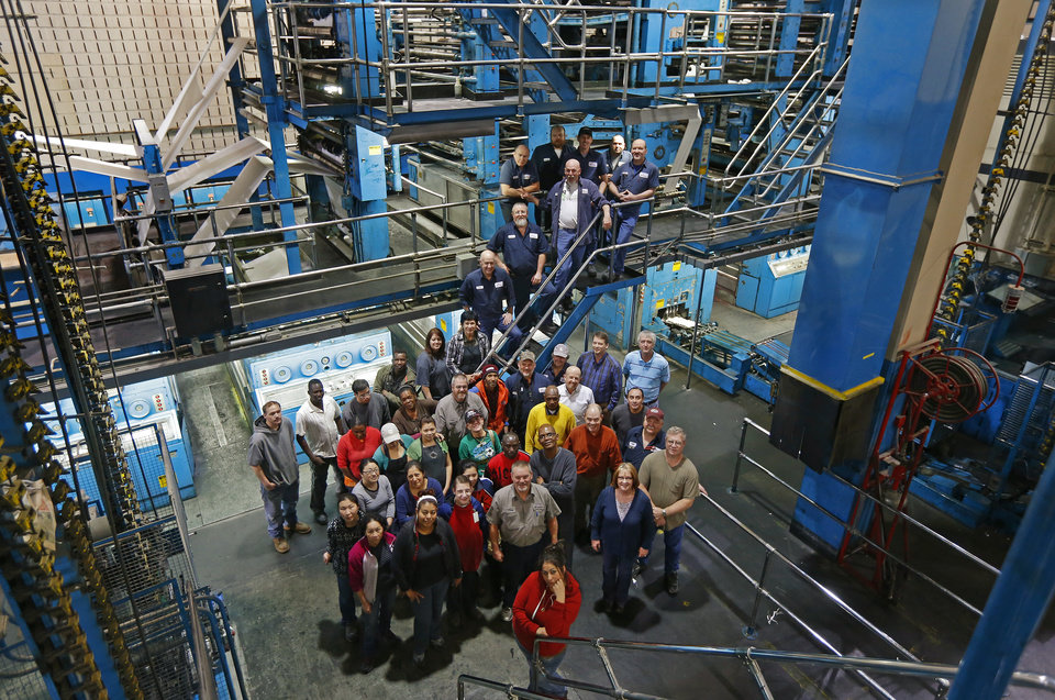 Photo -  Some of the day-shift workers at The Oklahoman's production plant gather at their workplace. About 175 production and distribution employees continue to work out of the north production facility near Britton Road and the Broadway Extension. Photo by Bryan Terry, The Oklahoman   BRYAN TERRY -  THE OKLAHOMAN