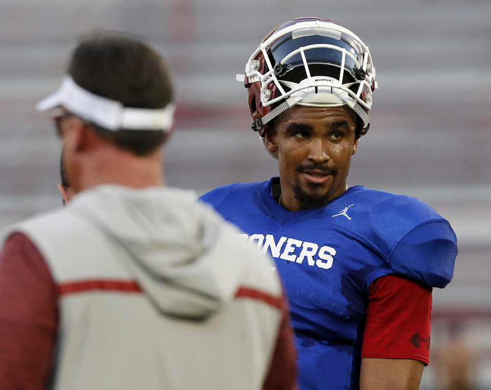 Photo - OU quarterback Jalen Hurts (1) during football practice for the University of Oklahoma Sooners at Gaylord Family - Oklahoma Memorial Stadium in Norman on Aug. 12. Wednesday, Hurts was named one of four captains for the Sooners. [Nate Billings/The Oklahoman]