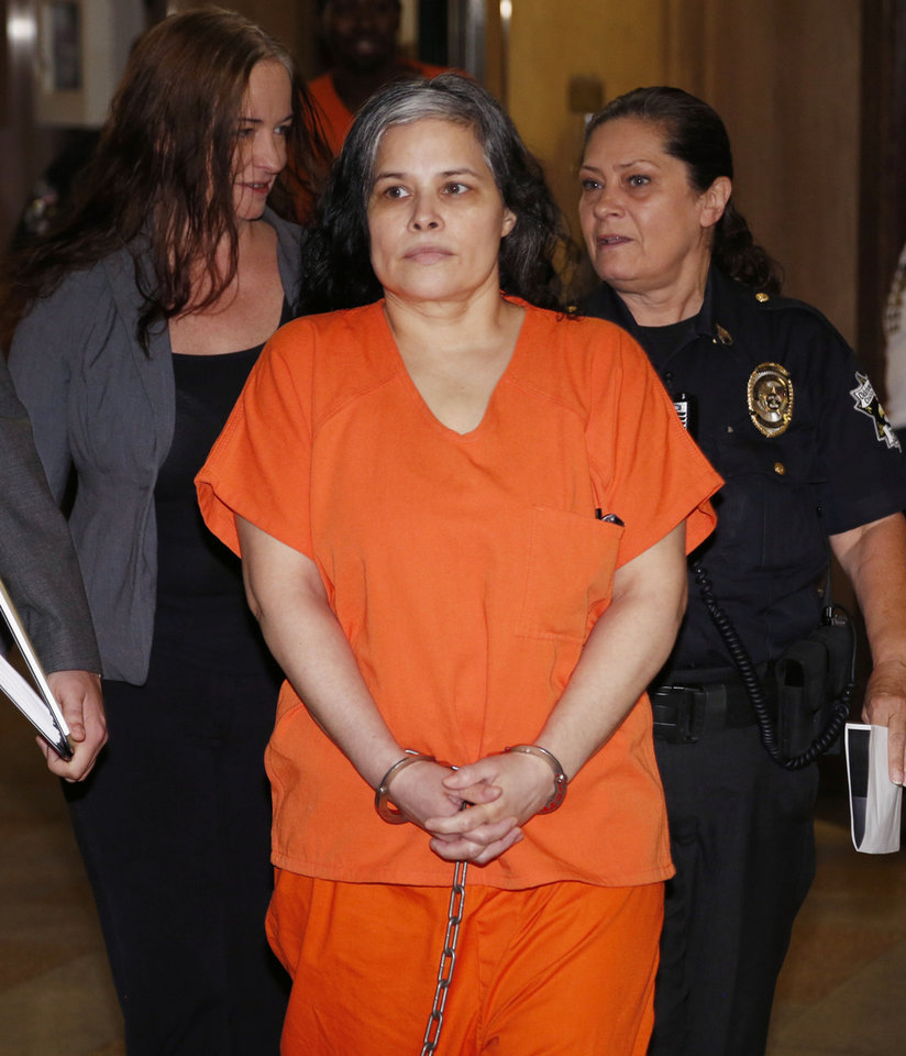 Photo -  Murder defendant Juanita Gomez appears in court Friday for her preliminary hearing. [Photo by Paul Hellstern, The Oklahoman]