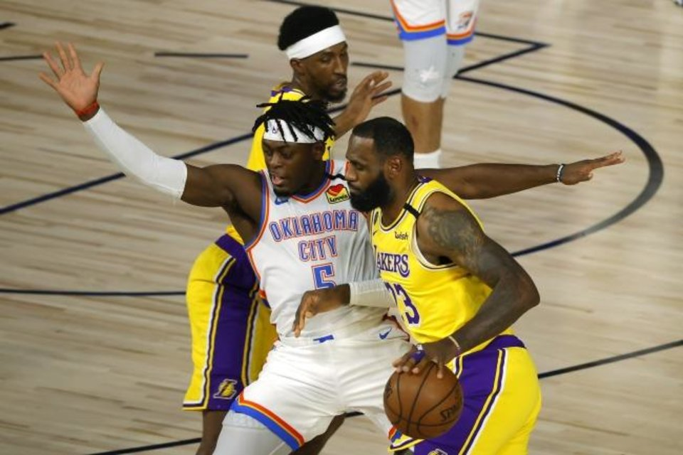 Photo -  Los Angeles Lakers' LeBron James is defended by Oklahoma City Thunder's Luguentz Dort during the first quarter of an NBA basketball game Wednesday, Aug. 5, 2020, in Lake Buena Vista, Fla. (Kevin C. Cox/Pool Photo via AP)