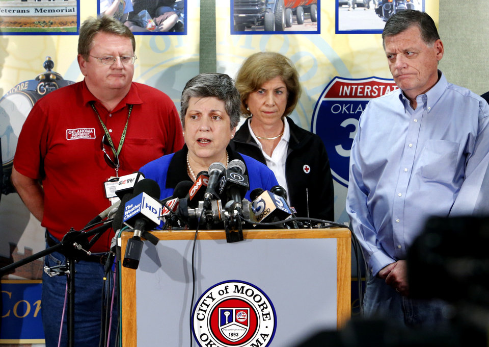 Photo - United State Secretary of Homeland Security Janet Napolitano addresses the media at a press conference concerning damage from Monday's tornado on Wednesday, May 22, 2013 at city hall in Moore, Okla. Behind left is Oklahoma Emergency Management Director Albert Ashwood and at right is Senator Tom Cole.  Behind Napolitano is Gail McGovern with the American Red Cross. Photo by Steve Sisney, The Oklahoman