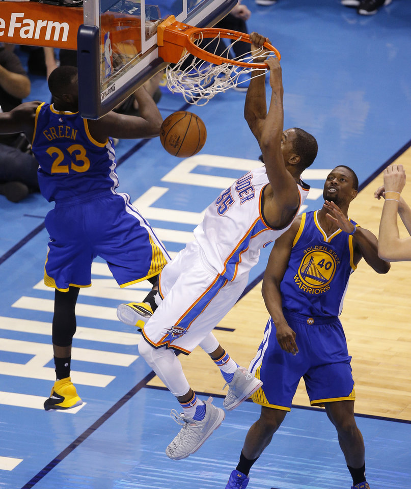 Photo - Oklahoma City's Kevin Durant (35) dunks between Golden State's Draymond Green (23) and Harrison Barnes (40) during Game 6 of the Western Conference finals in the NBA playoffs between the Oklahoma City Thunder and the Golden State Warriors at Chesapeake Energy Arena in Oklahoma City, Saturday, May 28, 2016. Photo by Bryan Terry, The Oklahoman