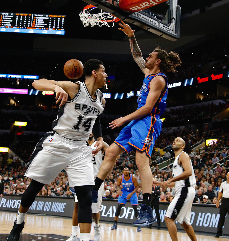 Photo - Oklahoma City's Steven Adams dunks the ball beside San Antonio's Danny Green during Game 2 of the second-round series between the Oklahoma City Thunder and the San Antonio Spurs in the NBA playoffs at the AT&T Center in San Antonio, Monday, May 2, 2016. Photo by Bryan Terry, The Oklahoman