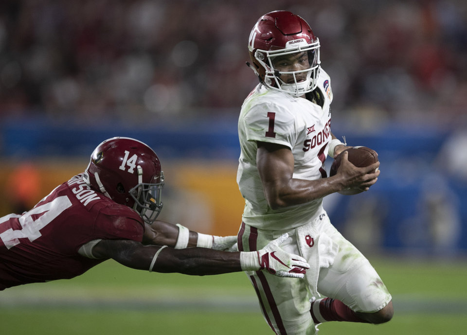 Photo -  Oklahoma quarterback Kyler Murray scrambles for yardage against Alabama's Deionte Thompson during Saturday's game in Miami Gardens, Fla. Murray ran for 109 yards and a touchdown. [PHOTO BY ALLEN EYESTONE, Palm Beach Post]