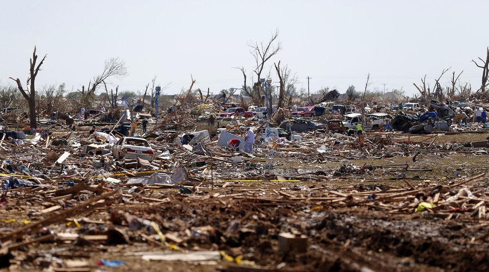 Photo - Damage to the Plaza Towers neighborhood in Moore, Okla., on Wednesday, May 22, 2013. The area was heavily damaged by a  tornado that struck on Monday, May 20, 2013. Photo by Bryan Terry, The Oklahoman