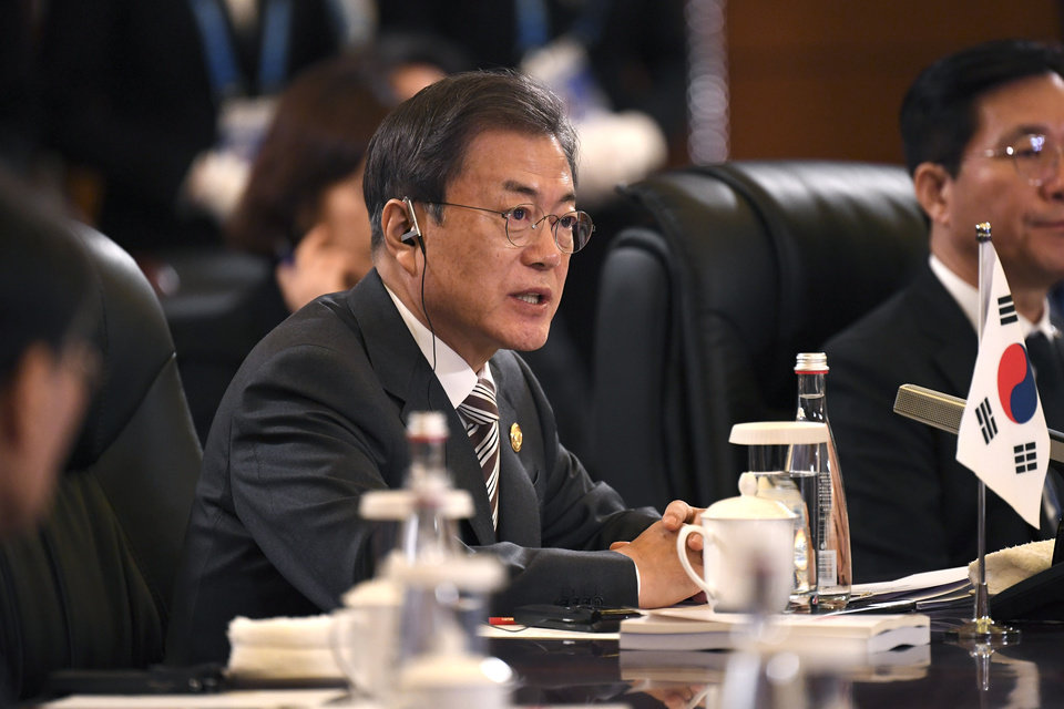 Photo -  South Korea's President Moon Jae-in speaks at the trilateral leaders' meeting between China, South Korea and Japan in Chengdu, China's Sichuan province Tuesday, Dec. 24, 2019.(Wang Zhao/Pool Photo via AP)
