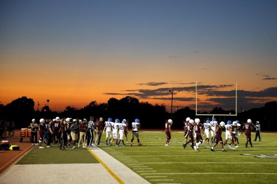 Photo -  The sun sets during a high school football game between Capitol Hill and Classes SAS at Speegle Stadium in Oklahoma City on Oct. 3. [Bryan Terry/The Oklahoman]