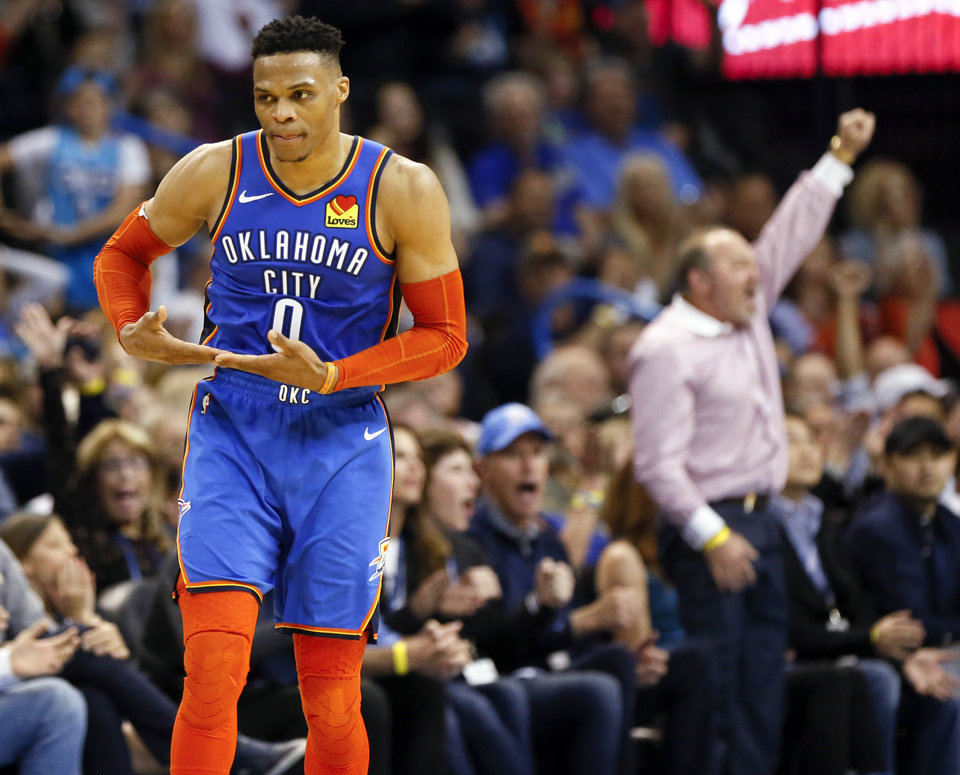 "Photo - Oklahoma City's Russell Westbrook (0) does his ""rock the baby"" celebration after making a basket late in the fourth quarter during an NBA basketball game between the Indiana Pacers and the Oklahoma City Thunder at Chesapeake Energy Arena in Oklahoma City, Wednesday, March 27, 2019. Oklahoma City won 107-99. Photo by Nate Billings, The Oklahoman"