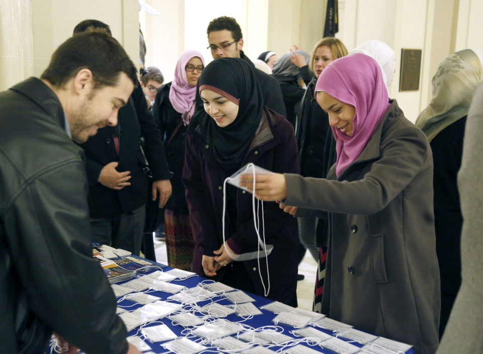 Photo - Muslims look for their name tags as CAIR and local Muslims gather at the State Capitol in Oklahoma City, OK, for Oklahoma Muslim Day, Friday, February 27, 2015,  Photo by Paul Hellstern, The Oklahoman