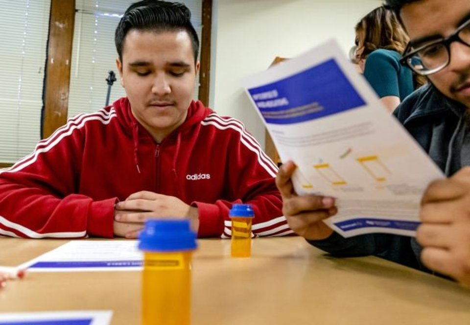 Photo -  Ricardo Melendrez reads over his drug disposal worksheet during the launch of an interactive prescription drug safety course designed for high school students at Capitol Hill High School in Oklahoma City, Okla. on Friday, Jan. 31, 2020. The safety program is launched by Attorney General Mike Hunter, executives from Walmart, EVERFI, and Oklahoma City Public Schools. [Chris Landsberger/The Oklahoman]