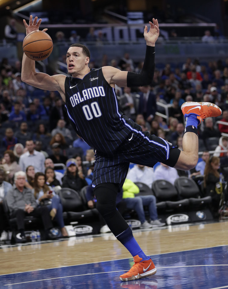 Photo - Orlando Magic's Aaron Gordon goes after a deflected pass during the second half of an NBA basketball game against the Oklahoma City Thunder, Tuesday, Jan. 29, 2019, in Orlando, Fla. (AP Photo/John Raoux)