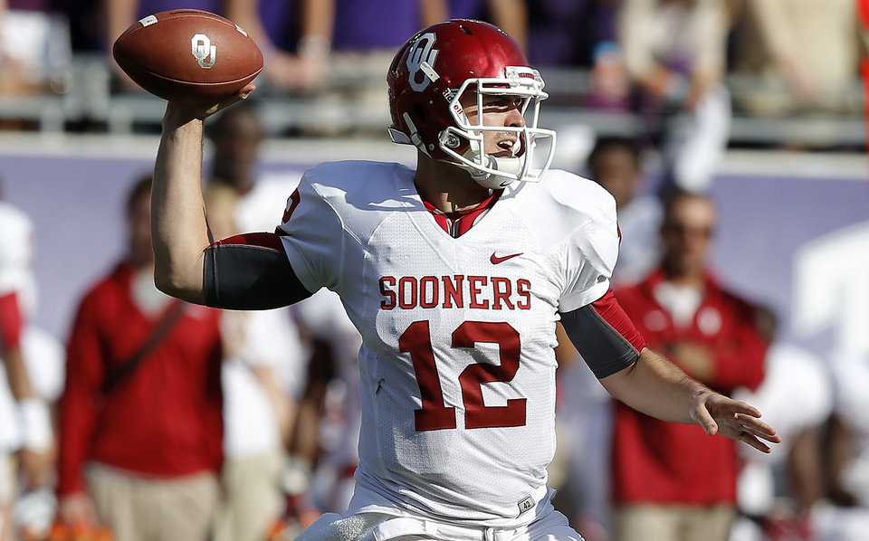 Photo - Oklahoma's Landry Jones (12) throws a pass during a college football game between the University of Oklahoma Sooners (OU) and the Texas Christian University Horned Frogs (TCU) at Amon G. Carter Stadium in Fort Worth, Texas, Saturday, Dec. 1, 2012. Oklahoma won 24-17. Photo by Bryan Terry, The Oklahoman