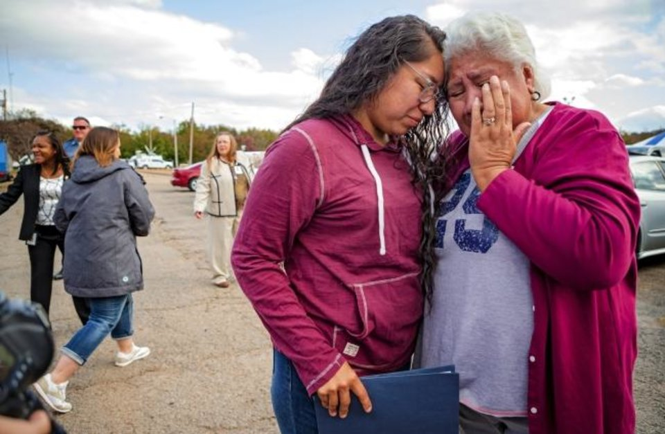 Photo -  Tess Harjo and her grandmother Sally Taylor embrace after Harjo was released from the Eddie Warrior Correctional Facility on Monday. Gov. Kevin Stitt greeted an estimated 70 women whose sentences he commuted from the facility. [Chris Landsberger/The Oklahoman]