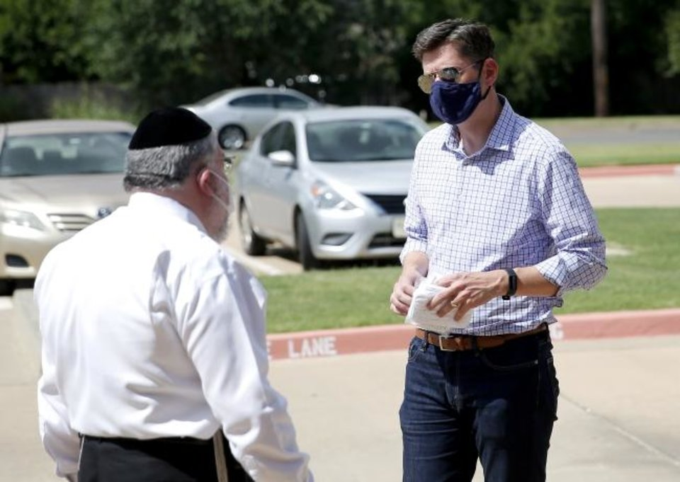 Photo -  Rabbi Ovadia Goldman and Oklahoma City Mayor David Holt talk during a drive-thru mask distribution at Chabad Community Center for Jewish Life and Learning, 3000 W Hefner Road. [Sarah Phipps/The Oklahoman]