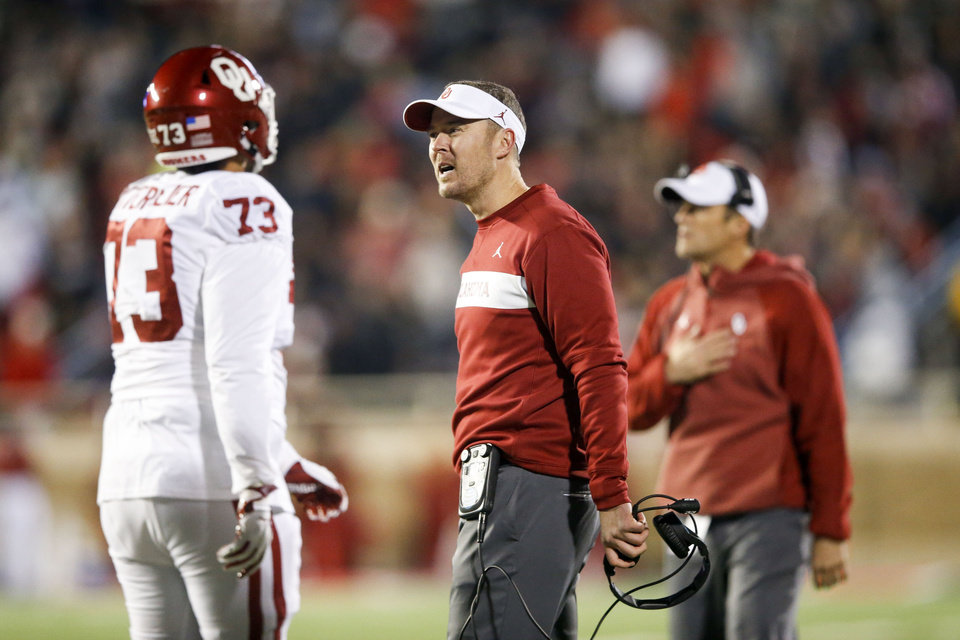 Photo - Oklahoma Sooners head coach Lincoln Riley  talks to Oklahoma Sooners offensive lineman Quinn Mittermeier (73) during the NCAA football game between the Texas Tech Red Raiders and the Oklahoma Sooners at Jones AT&T Stadium in Lubbock, Texas on Saturday, November 03, 2018. IAN MAULE/Tulsa World
