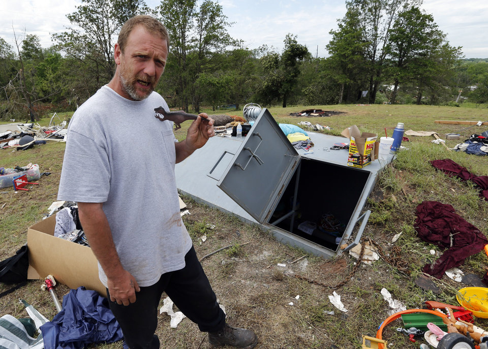 Photo - Terry DeSpain stands in front of the shelter where he, his family and several neighbors sought refuge from Sunday's tornado in the Woodlands and Pecan Valley area on Thursday, May 23, 2013 in Little Axe, Okla.  Photo by Steve Sisney, The Oklahoman