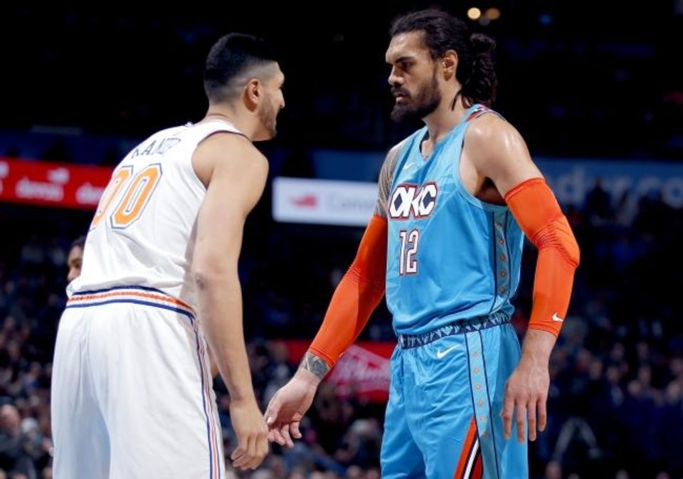 Photo -  Steven Adams (12) and Enes Kanter defend against each other during the Thunder's win against the Knicks on Nov. 14 in Oklahoma City. [Sarah Phipps/The Oklahoman]