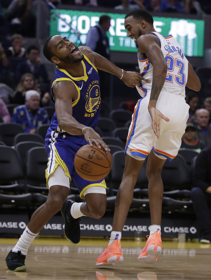 Photo - Golden State Warriors' Alec Burks, left, drives the ball around Oklahoma City Thunder forward Terrance Ferguson (23) in the second half of an NBA basketball game, Monday, Nov. 25, 2019, in San Francisco. (AP Photo/Ben Margot)