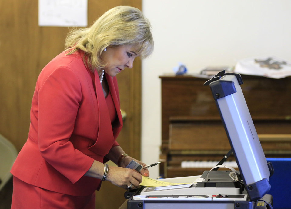 Photo - Oklahoma Governor Mary Fallin casts her vote at Prospect Baptist Church in Oklahoma City, Okla. during the primary election, Tuesday, June 28, 2016.  Photo by Paul Hellstern, The Oklahoman
