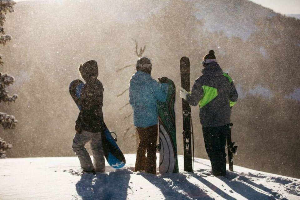 Photo -  Skiers take in the view from the 12,075-foot summit at Ski Santa Fe. [Photo provided]