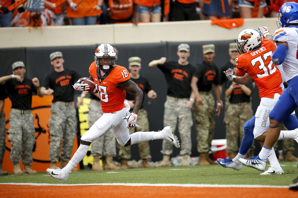 Photo - Oklahoma State's Za'Carrius Green (18) scores a touchdown following a blocked punt in the third quarter during a college football game between the Oklahoma State Cowboys (OSU) and the Boise State Broncos at Boone Pickens Stadium in Stillwater, Okla., Saturday, Sept. 15, 2018. OSU won 44-21. Photo by Sarah Phipps, The Oklahoman