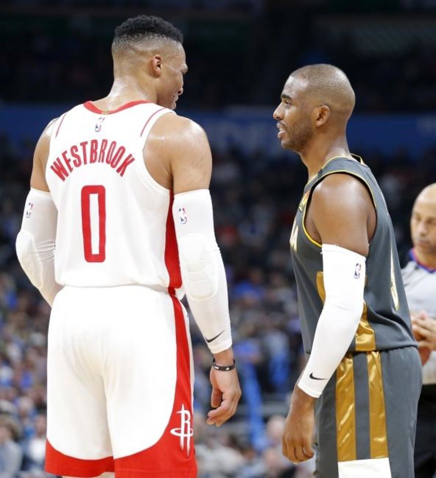 Photo -  Houston's Russell Westbrook (0) talks with the Thunder's Chris Paul (3) during a regular season game in January at Chesapeake Energy Arena in Oklahoma City. [Bryan Terry/The Oklahoman]