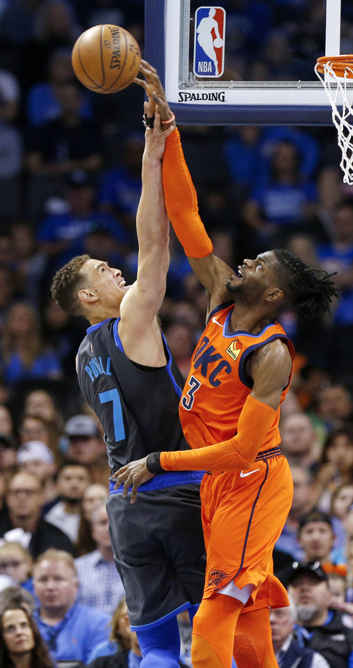 Photo - Oklahoma City's Nerlens Noel (3) blocks a shot by Dallas' Dwight Powell (7) in the second quarter during an NBA basketball game between the Dallas Mavericks and the Oklahoma City Thunder at Chesapeake Energy Arena in Oklahoma City, Sunday, March 31, 2019. Photo by Nate Billings, The Oklahoman