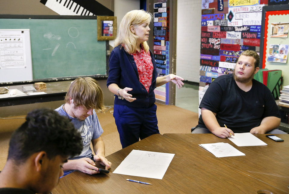 Photo - Principal Elizabeth Ressel talks to Jared Bartley, 17, of Waurika, right, near Adam Stedman, 17, of Comanche, left, and Jayden Miley, 15, of Comanche, in the art room at FAME Academy, an alternative school in Comanche Public Schools, in Meridian, Okla., Wednesday, Oct. 3, 2018. Photo by Nate Billings, The Oklahoman