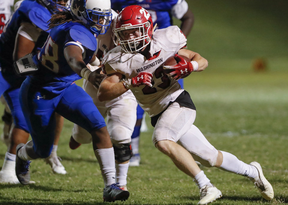 Photo - Washington's Lance Spaulding runs for a first down against Millwood during the first half of a game in Oklahoma City on Oct. 5, 2018. [Alonzo Adams/For The Oklahoman]
