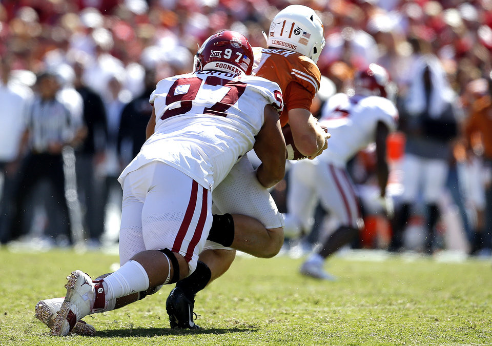 Photo - Oklahoma's Marquise Overton (97) sacks Texas quarterback Sam Ehlinger (11) in the fourth quarter during the Red River Showdown college football game between the University of Oklahoma Sooners (OU) and the Texas Longhorns (UT) at Cotton Bowl Stadium in Dallas, Saturday, Oct. 12, 2019. OU won 34-27. [Sarah Phipps/The Oklahoman]