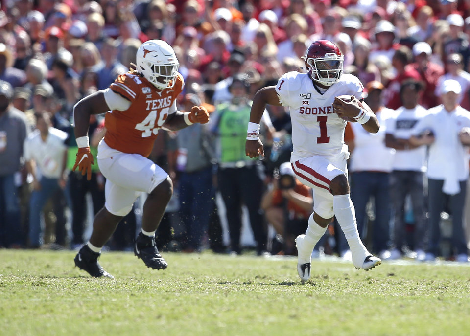 Photo - Oklahoma's Jalen Hurts (1) rushes as he is chased by Texas's Ta'Quon Graham (49) during the Red River Showdown college football game between the University of Oklahoma Sooners (OU) and the Texas Longhorns (UT) at Cotton Bowl Stadium in Dallas, Saturday, Oct. 12, 2019. OU won 34-27. [Sarah Phipps/The Oklahoman]