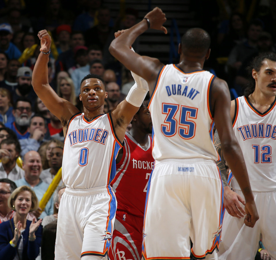 Photo - Oklahoma City's Russell Westbrook (0) and Kevin Durant (35) celebrate a block during an NBA basketball game between the Oklahoma City Thunder and the Houston Rockets at Chesapeake Energy Arena in Oklahoma City, Friday, Jan. 29, 2016. Oklahoma City won 116-108. Photo by Bryan Terry, The Oklahoman